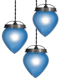 We see a ton of lighting but these striking blue acorn shaped pendents are a first for us. The blue color is soft and very pleasing. The inside of the glass is frosted and produces a nice even light. They are a good size with 7.5 inch diameters and 10 inches tall. The glass opening is large for the shades size so it uses a large cast brass fixture above. There is a collection of 5 lamps. They are priced at $475 each. Buy one or all five.