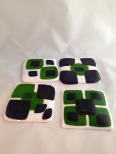Fused glass coasters in purple and green.  Set by SassyGlassBySuzy