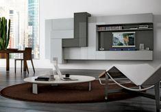 Удобное и практичное оформление зоны для просмотра телевизора.