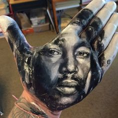 Artist Russell Powell paints stunningly realistic portraits on his hand and stamps them on paper. #art #bodyart