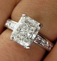 From our Estate Collection. The total diamond weight is 3.18ct  A beautifully designed Radiant cut Diamond Solitaire ring with almost 2.50ct (