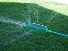 DIY sprinkler! All you need is an empty soda bottle, duct tape, and a hose. Poke holes on just 3 sides of the bottle with a screwdriver or something sharp, tape the hose to it, and there you have it! Cheap, fun, and perfect for hot days!