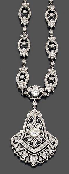 Platinum and diamond necklace, circa 1920. The openwork pendant set with a range…