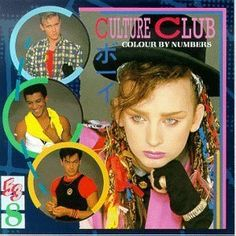 """Boy George.  Hat, LOTS of colorful """"brades"""" half gloves, long coat or colorfull over sized clothes and makeup."""