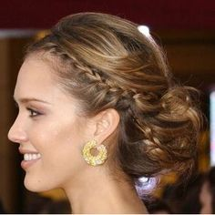 Jessica Alba low bun with braids