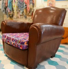 French leather club chairs with cushions repleaced with Guatemala fabric