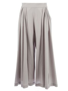 Nude wool trousers featuring a wide leg cut and pleats to the legs.