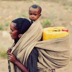 woman carying child and water