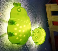 The IKEA Home Tour Squad used the SMILA BAGGE children's light as a fun nightlight in their children's bedroom makeover.