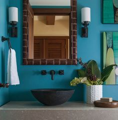 Stone basin, rich blue wall color, and a white quilted pot.  Love this take on a tropical bedroom vibe!