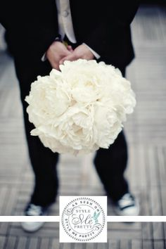 peonies are great because they are big and cheap.  they add an airy look for a garden fairy tale wedding and let you have a big bouquet without spending a fortune on a lot of pricey flowers