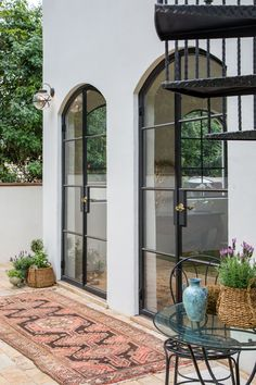 Beautiful Steel doors in one of our homes! We love the Spanish Transitional style! Spanish Home Decor, Spanish Colonial Homes, Spanish Bungalow, Spanish Style Homes, Spanish House, Spanish Revival, Casa San Sebastian, Spanish Modern, Plans Architecture