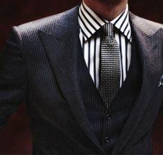 Black Suit. Black Vest. Checkered Tie. Striped Shirt.