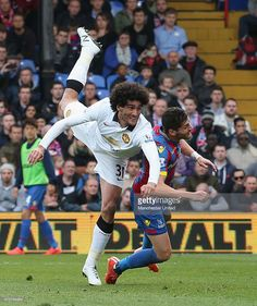 LONDON, ENGLAND - MAY Marouane Fellaini of Manchester United in action with Joel Ward of Crystal Palace during the Barclays Premier League match between Crystal Palace and Manchester United at Selhurst Park on May 2015 in London, England. Joel Ward, Barclay Premier League, Soccer News, Sport Inspiration, Manchester United Football, Best Club, English Premier League, Premier League Matches, Professional Football
