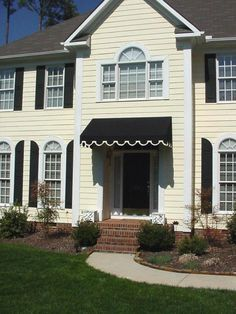 Black Fabric Awning On House With White Outlines Fabric