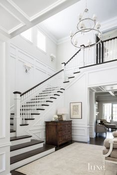white millwork and dark wood steps and rail.  Like this style and colors. Not sure we'd like wood stairs.