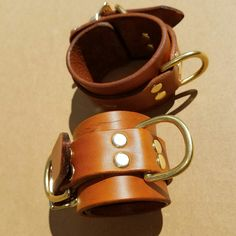 Gorgeous antiqued tan locking cuffs with brass hardware!  Dominion Leather at http:\\DominionLeather.etsy.com #DominionLeather #Dominion Leather #bondage #leather #cuff #bdsm #belt