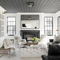 Black Linen Sectional with White Tufted Ottoman as Coffee Table
