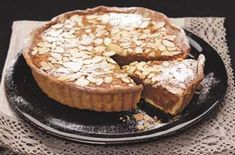 Crushed Amaretti biscuits and a shot of almond liqueur give this wickedly delicious treacle tart an added twist. Go on, treat yourself to a slice! Uk Recipes, Tart Recipes, Sweet Recipes, Dessert Recipes, Desserts, Amaretti Biscuits, Treacle Tart, Almond Pastry, Savory Tart