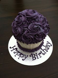 Purple sparkly giant cupcake by Kelscupcakes, via Flickr