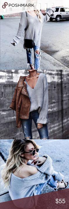 Oversized V Neck Sweater Oversized knit v neck sweater with cuff sleeves. Sweaters V-Necks