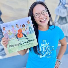 """The New York Times bestselling author of Eyes That Kiss in the Corners, Joanna Ho, delivers a poignant picture book biography about the musician Yo-Yo Ma, immigration, and using music to build bridges. Staying true to himself, Yo-Yo Ma performed at the US-Mexico border at the Rio Grande on April 13, 2019, as part of his multi-continent """"Bach Project"""" tour to prove a point—through music, we can build bridges rather than walls between different cultures. 📸 @joannahowrites National Book Store, Cool Pictures, Beautiful Pictures, April 13, American Presidents, Rio Grande, Picture Books, Book Lists, New York Times"""