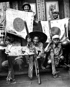 A US soldier, a Chinese Nationalist soldier, and guerrillas display captured Japanese flags and armaments after the liberation of Tengchong, 1945 [ Ww2 Pictures, Ww2 Photos, Photographs, World History, World War Ii, Asian History, American Soldiers, Military History, American History