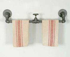 """This industrial towel rack features a valve in the middle as a divider, or to hang items from. This piece measures 23½"""" long and 4¼"""" deep."""