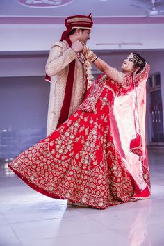 "Bluefox camera ""Portfolio"" album - Candid Couple Shot - Bride in a Red lehenga Gown and Groom in a Beige Suit. WeddingNet #weddingnet #indianwedding #indianbride #bride #bridal #sequinned #lehenga #bridallehenga #weddinglehenga #suit #green #gold #red"