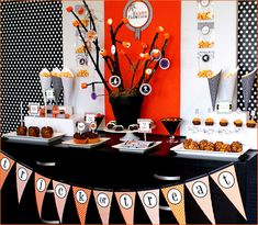 """We wanted to design a dessert table that would be easy and economical for any hostess to replicate at their own Halloween Bash. The paper elements from our printable party collection were used on everything from the food flags to the cupcake toppers. Other key details included:    ACCESSORIES & DECOR:  • Black Tree Centerpiece: we used black spray paint to cover a terra-cotta pot with moss and branches from the backyard, then we decorated the branches with paper logo ornaments and orange…"