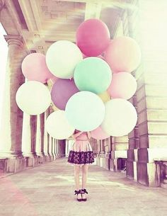 Love the big round balloons and her bowtie shoes!
