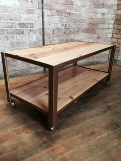 Steel frame and wooden shelf coffee table on wheels. To see more www.facebook.com/UltimateDIYGuy.