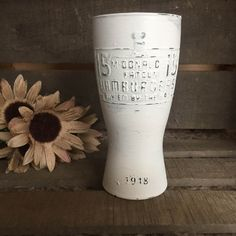This listing is for one (1) Vintage White Painted 1948 McDonald's Anniversary Glass.  This glass has been hand painted and given a distressed, one-of-a-kind look.  This collector's item reads and is embossed with the saying '15 cent McDONALD'S FAMOUS HAMBURGERS Buy 'EM BY THE BA