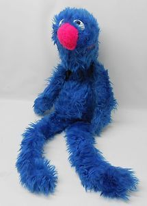 Sesame Street Grover (70's). I still have mine!  Maddy loves him!  Especially since I always put baby diapers on Grover!
