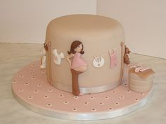 I am loving this baby shower cake.... It would be so fun to create.