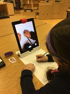 In our Baby Project, Students use the Osmo app to sketch themselves as babies.