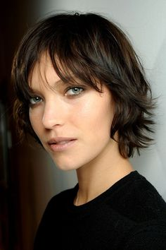 There are pretty much NO graceful ways to grow out short hair. This comes close, but it might just be because she is a beautiful model.