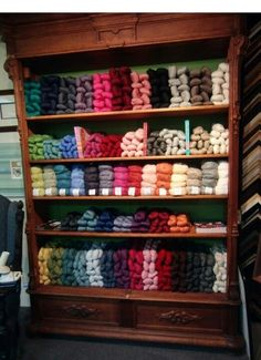 Great Pacific Yarn Shop and Gallery display of Cascade Yarn : I love the colors of the yarn and the neatness of the cupboard.