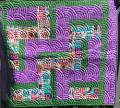 A little lap quilt with pretty baptist fans quilted on it. Love this color combination.