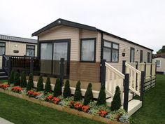 Fensys decking fitted with bronze tinted toughened glass and stainless steel glass clamps Plastic Fencing, Decking Suppliers, Caravan Holiday, Caravan Makeover, Led Manufacturers, Park Homes, Caravans, Fence, Caravan Ideas