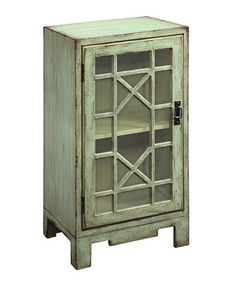 beautiful color aqua and love the window front of this small cabinet