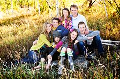 another great large family portrait.  Love the pose, love the colors and style even more.  You don't have to be matchy matchy to go together perfectly.