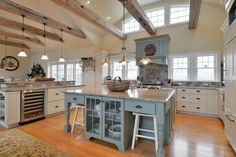 Country Kitchen with Vinotemp 50-Bottle Wine Cooler with Interior Display, Arched window, Exposed beam, Wine refrigerator
