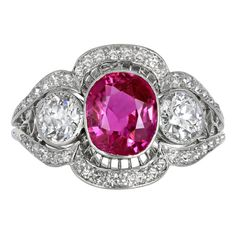 Platinum vintage Edwardian ring consisting of 1 cushion cut No Heat Burma ruby weighing approx 2.40 carats set with approx 1.10 carats total weight of old European cut diamonds, circa 1910.