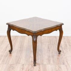 This french provincial end table is featured in a solid wood with a glossy dark oak finish. This side table is in great condition with cabriole legs, carved curved trim and a parquet table top. Elegant table perfect for a lamp and books! #frenchprovincial #tables #endtable #sandiegovintage #vintagefurniture