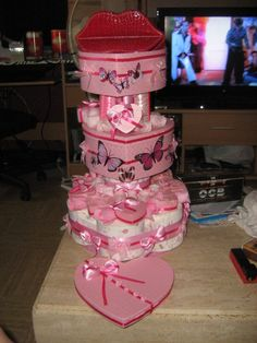 cake tins and toilet paper hearts, ribbon, homemade soap, jewelry, butterfly glue