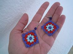 These granny square earrings are crocheted with a very fine hook . I used mercerised cotton in lavender blue, red and pale blue and two blue swarovski beads to make them. Length: 5.5 cm/ 2.2 in (measured from under the hook) For more of my earrings:
