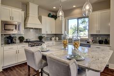 The Broadway floor plan has a gorgeous kitchen. It includes slab granite countertops and center island as well as commercial-grade stainless steel appliances.