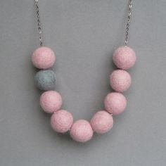 Pale Pink Statement Necklace - Candyfloss Pink Felt Necklace with Felted Gray Accent Bead - Chunky Felt Ball Jewelry by annakingjewellery on Etsy https://www.etsy.com/listing/93232371/pale-pink-statement-necklace-candyfloss