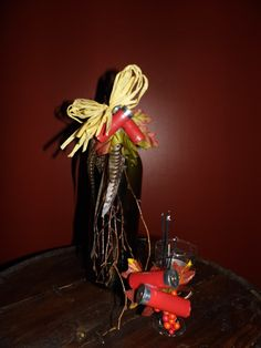 wine bottle candle holder and wine glass candle holder. decorated with shot gun shells